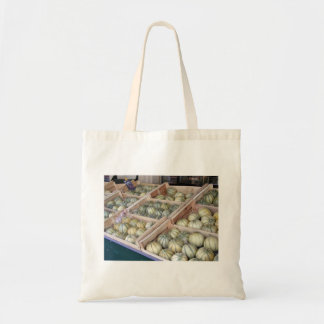 Charentais melons displayed in grocery store budget tote bag