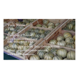 Charentais melons displayed in grocery store pack of standard business cards