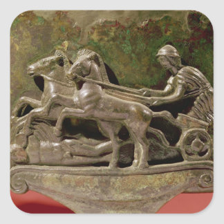 Charioteer in his chariot, detail from a cist square sticker