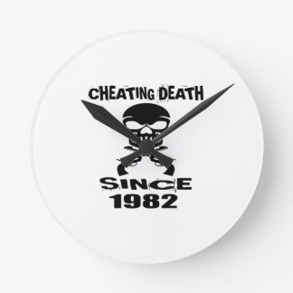 Cheating Death Since 1982 Birthday Designs Round Clock
