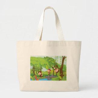 Cheeky monkeys tote bags