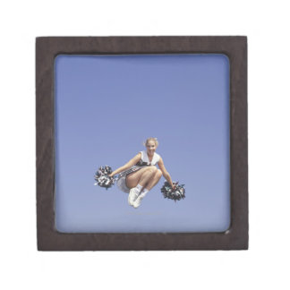 Cheerleader jumping, low angle view, portrait premium trinket boxes
