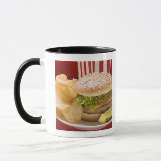 Cheeseburger with potato crisps and gherkin mug