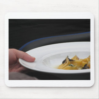 Chef holding cooked handmade Agnolotti to serve Mouse Pad