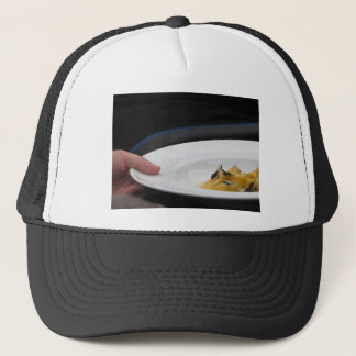 Chef holding cooked handmade Agnolotti to serve Trucker Hat