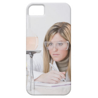 Chemist looking at Bunsen burner Case For The iPhone 5