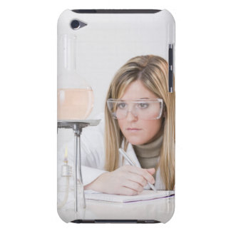 Chemist looking at Bunsen burner iPod Touch Covers