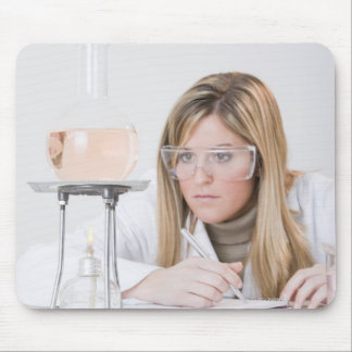 Chemist looking at Bunsen burner Mouse Pad