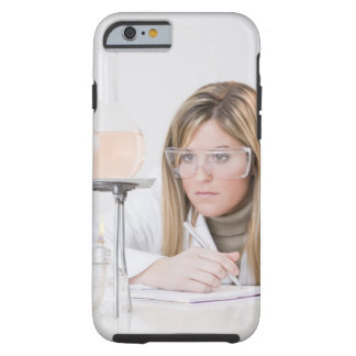 Chemist looking at Bunsen burner Tough iPhone 6 Case