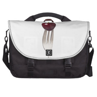 Cherry held by a fork laptop bags