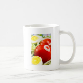 Cherry tomatoes and boiled eggs in a salad coffee mug