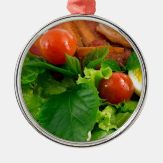Cherry tomatoes, herbs, olive oil, eggs and bacon metal ornament