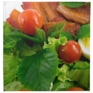 Cherry tomatoes, herbs, olive oil, eggs and bacon napkin
