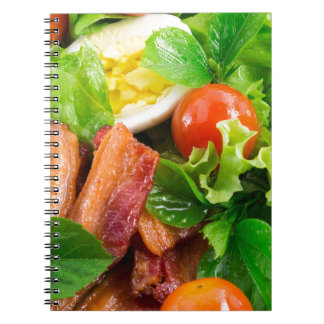 Cherry tomatoes, herbs, olive oil, eggs and bacon notebooks