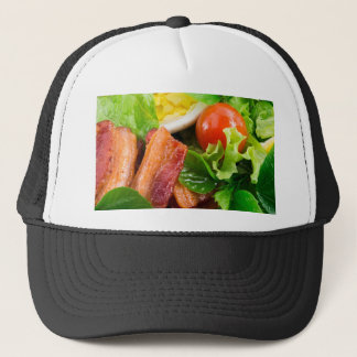 Cherry tomatoes, herbs, olive oil, eggs and bacon trucker hat
