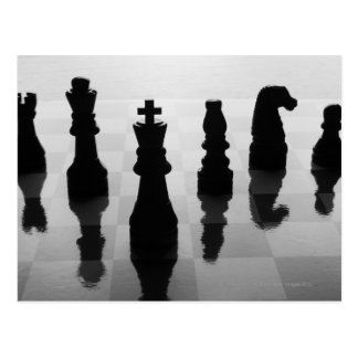 Chess pieces on chess board in black and white postcard
