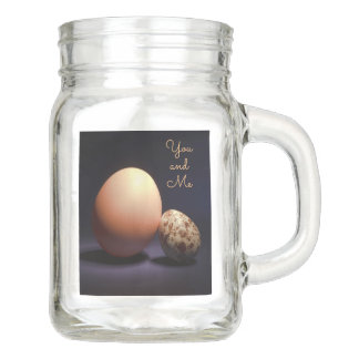 Chicken and quail eggs in love. Text «You and Me». Mason Jar