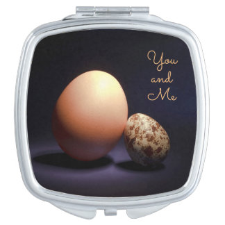 Chicken and quail eggs in love. Text «You and Me». Mirror For Makeup