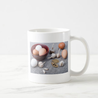 Chicken eggs and garlic and spices on the kitchen coffee mug