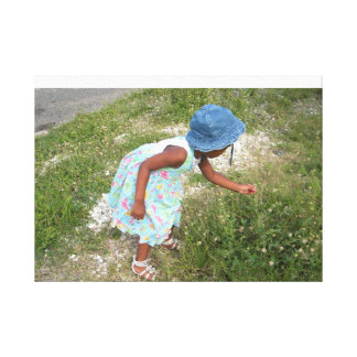 child in the meadow stretched canvas prints