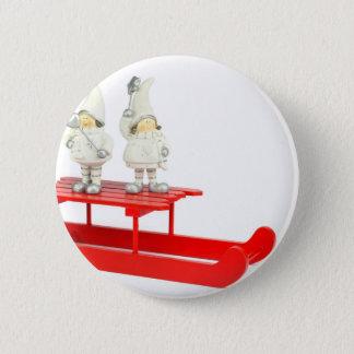 Children christmas figurines on red sleigh 6 cm round badge