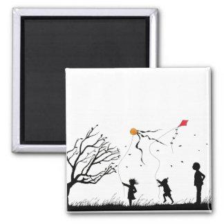 Children flying kites square magnet