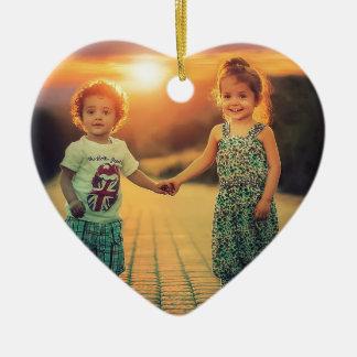 Children holding hands sunset love ceramic ornament