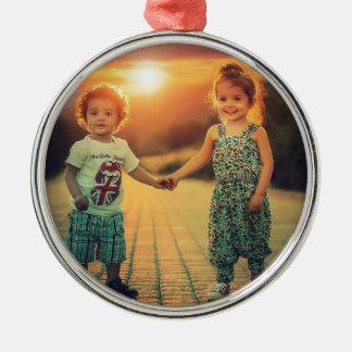 Children holding hands sunset love metal ornament