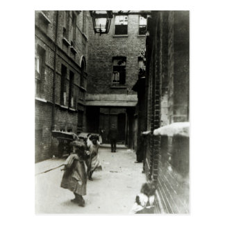 Children playing in a slum, 1899 postcard