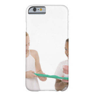Children with a model set of teeth and oversized barely there iPhone 6 case