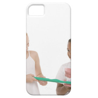 Children with a model set of teeth and oversized iPhone 5 case