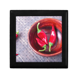 Chilli hot red pepper in a brown wooden bowl gift box