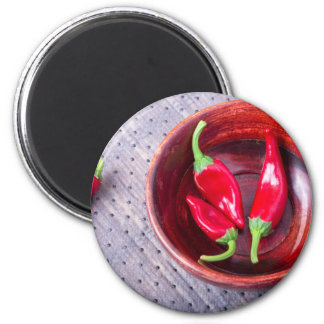 Chilli hot red pepper in a brown wooden bowl magnet