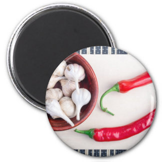Chilli peppers and garlic in a wooden bowl 6 cm round magnet