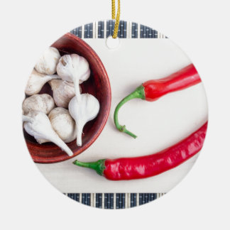 Chilli peppers and garlic in a wooden bowl ceramic ornament