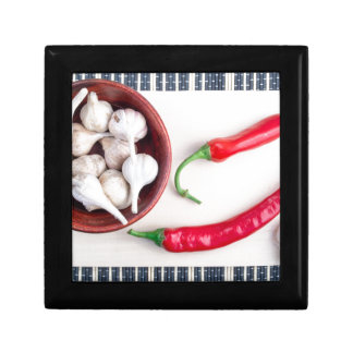 Chilli peppers and garlic in a wooden bowl gift box
