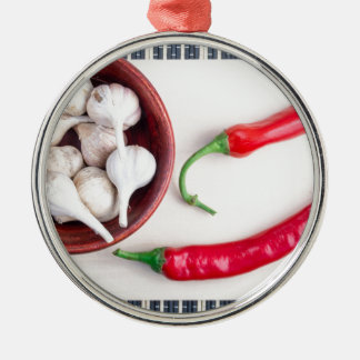 Chilli peppers and garlic in a wooden bowl metal ornament