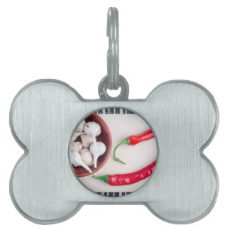 Chilli peppers and garlic in a wooden bowl pet tag