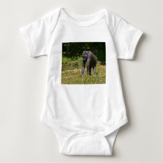 Chimpanzee in the flowering grass baby bodysuit