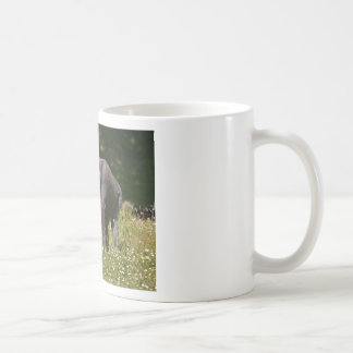 Chimpanzee in the flowering grass coffee mug