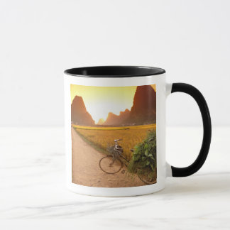 China, Guangxi. Yangzhou, Bicycle on country Mug