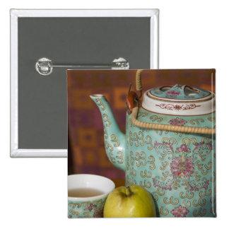China, Hong Kong. Traditional Chinese teapot & 2 15 Cm Square Badge