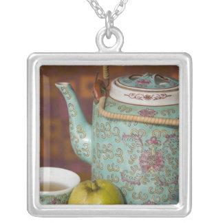 China, Hong Kong. Traditional Chinese teapot & 2 Square Pendant Necklace