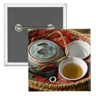 China, Hong Kong. Traditional Chinese teapot & 3 15 Cm Square Badge