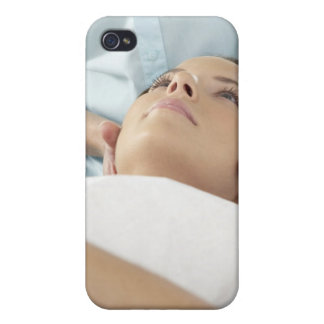 Chiropractic treatment of the neck using the cover for iPhone 4
