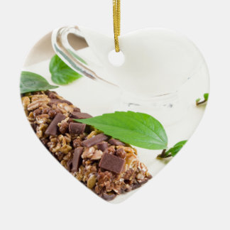 Chocolate bar with a cereal and milk for breakfast ceramic heart decoration