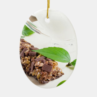 Chocolate bar with a cereal and milk for breakfast ceramic oval decoration