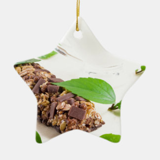Chocolate bar with a cereal and milk for breakfast ceramic star decoration