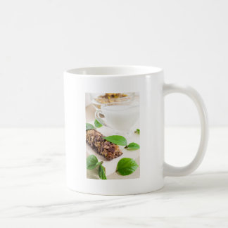 Chocolate bar with a cereal and milk for breakfast coffee mug