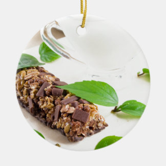 Chocolate bar with a cereal and milk for breakfast round ceramic decoration